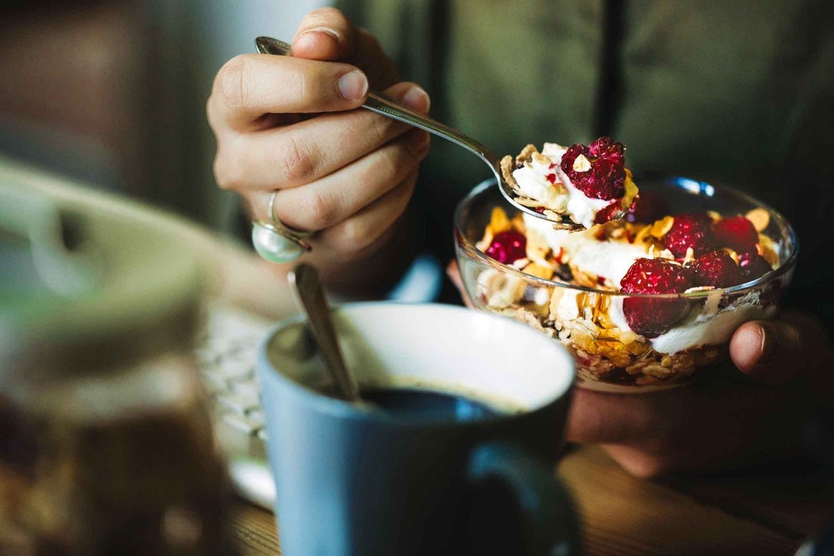 person eating healthy breakfast