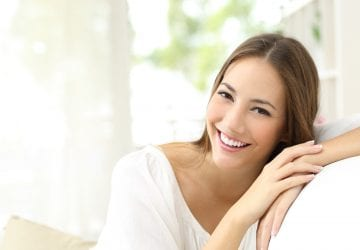 Beauty woman with white perfect smile looking at camera at home