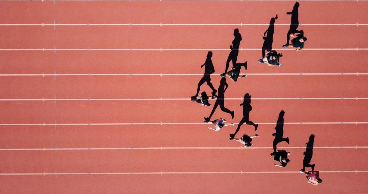 a group of athletes running on a track