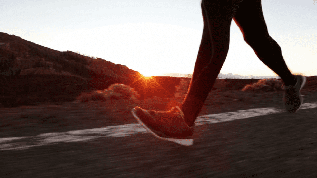 person running at sunset