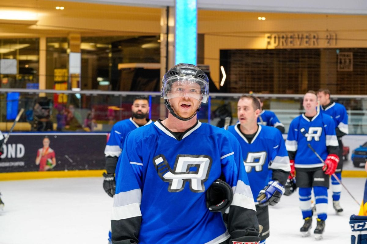 a group of men playing hockey