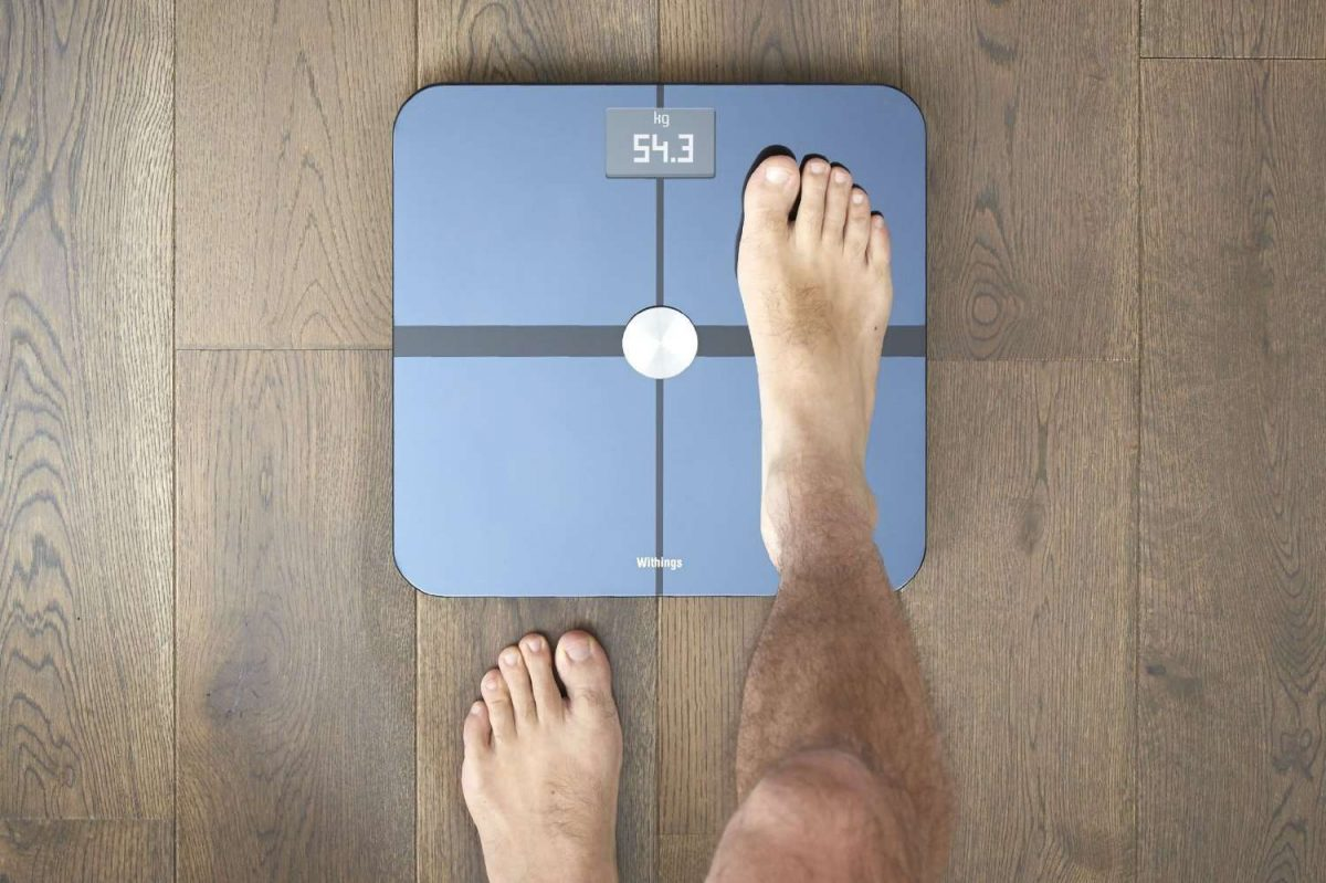 a person stepping onto a scale